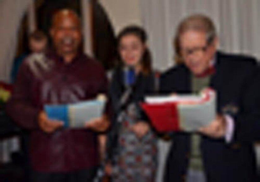 armanda Portella is joined in song by american legion Post 275 Commander Jose Payne King (left) and Herman Froeb at december's holiday event. Courtesy