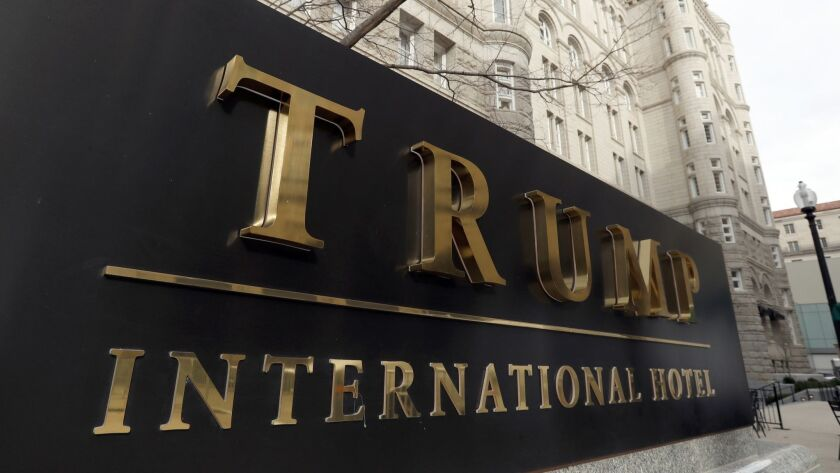 FILE - In this Dec. 21, 2016, file photo, The Trump International Hotel at 1100 Pennsylvania Avenue