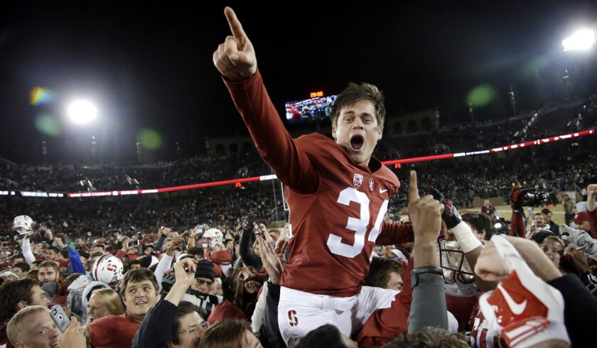 Stanford place kicker Conrad Ukropina is lifted by fans and teammates after hitting a 45-yard field goal as time expired to give Stanford a 38-36 win over Notre Dame Nov. 28.