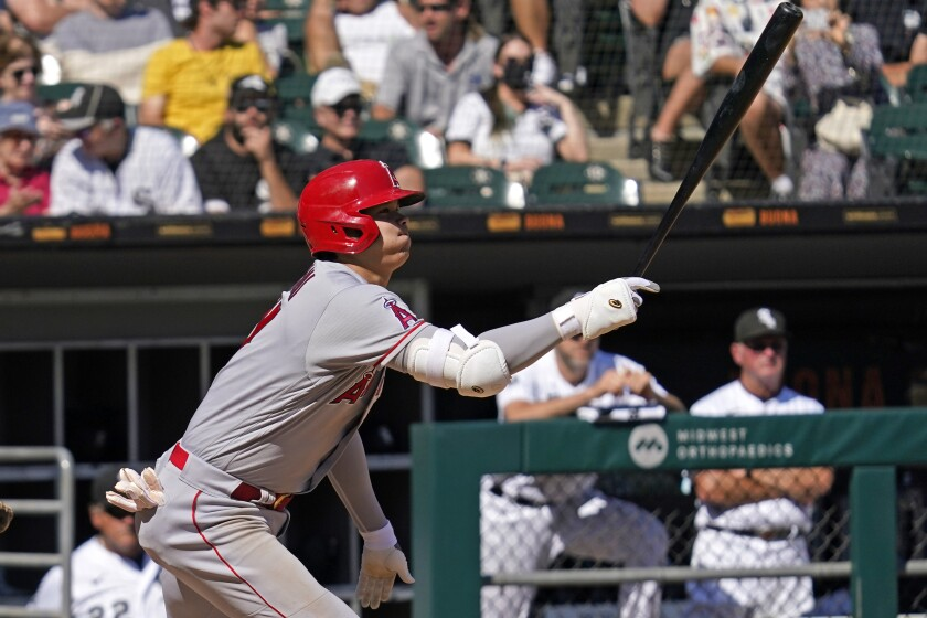 Los Angeles Angels designated hitter Shohei Ohtani, of Japan, hits a single during the fifth inning of a baseball game against the Chicago White Sox in Chicago, Thursday, Sept. 16, 2021. (AP Photo/Nam Y. Huh)