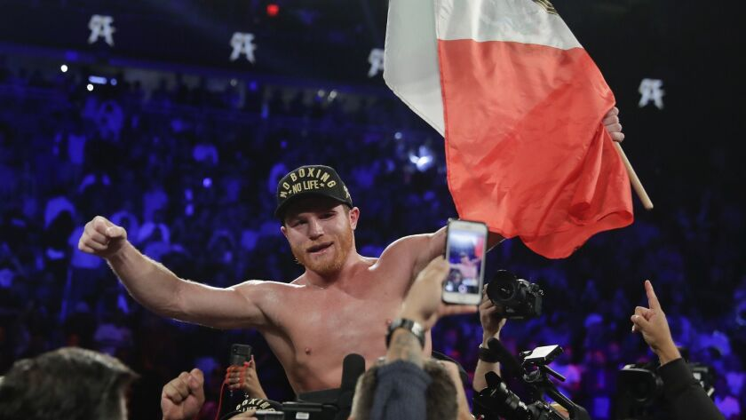 Canelo Alvarez celebrates after defeating Gennady Golovkin by majority decision in a middleweight ti