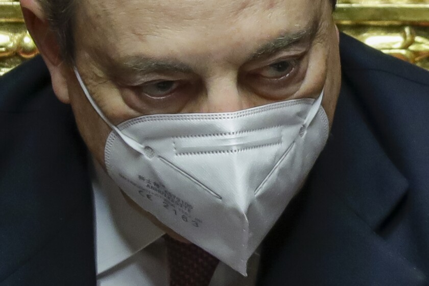Close-up of Mario Draghi wearing a mask