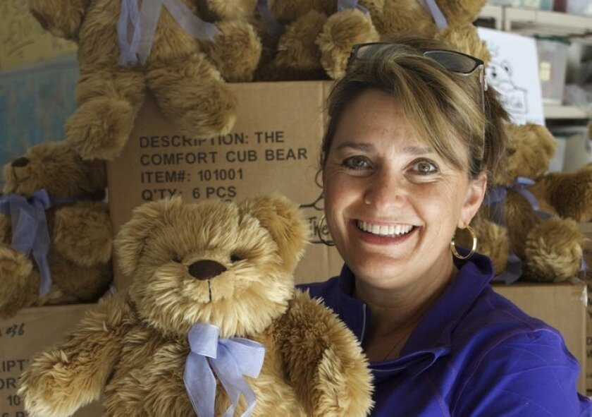 Comfort Cub founder and La Jolla High School graduate Marcella Johnson with one of her weighted bears.