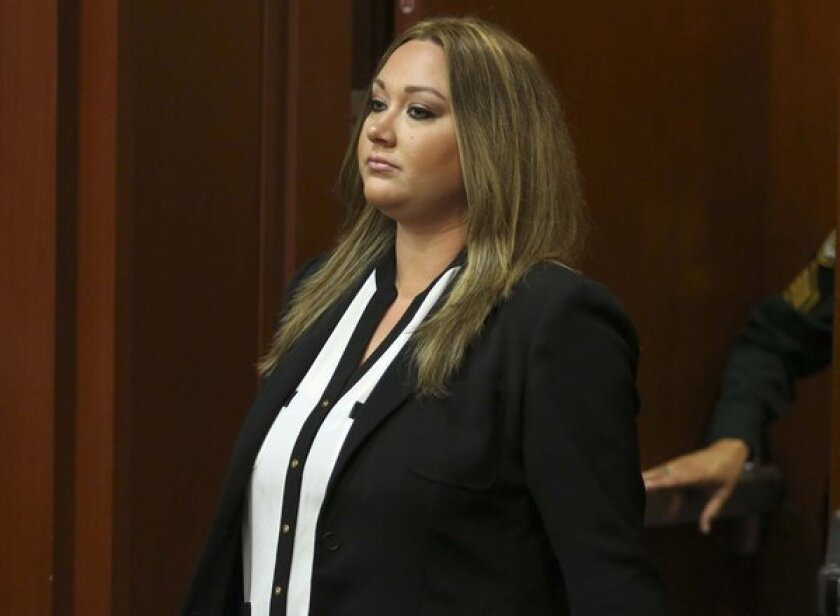 Shellie Zimmerman, wife of George Zimmerman, pleads guilty to a lesser form of perjury at the Seminole County Courthouse in Sanford, Fla.