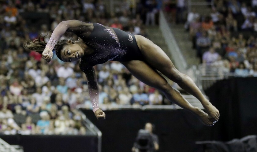 Simone Biles competes in the floor exercise.