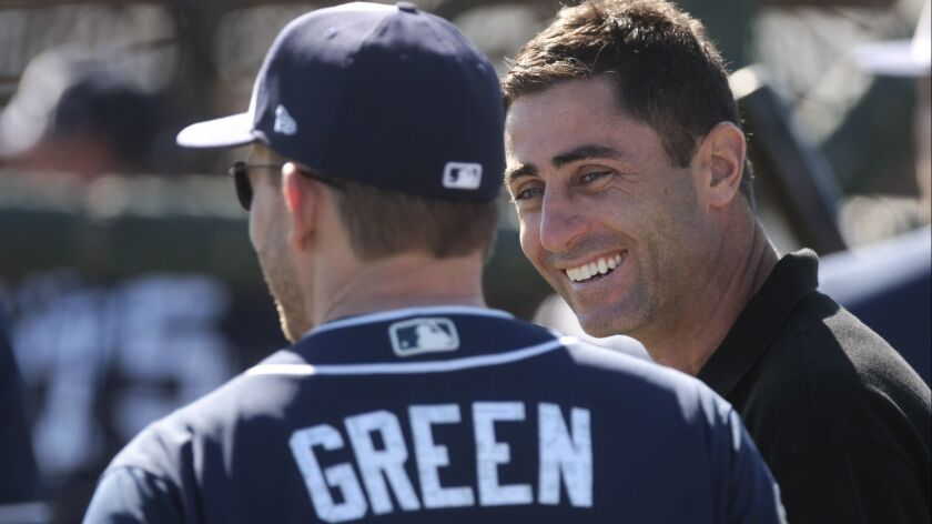 Padres manager Andy Green and Padres general manager A. J. Preller talk during the first official workout for catchers and pitchers at the Peoria Sports Complex in Peoria, Arizona on Wednesday, Feb. 15, 2017.