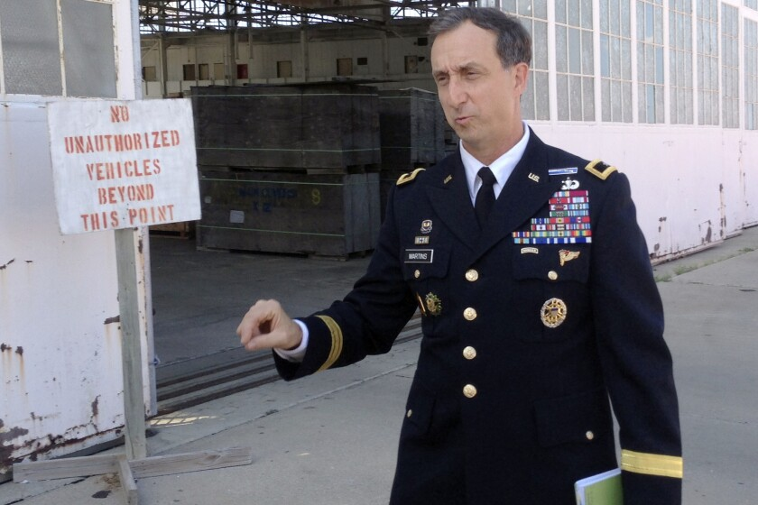 FILE - In this Oct. 23, 2015 photo, U.S. Army Brig. Gen. Mark Martins, the chief prosecutor at the U.S. military commission at Guantanamo Bay, Cuba, speaks during a break in pretrial proceedings for the five men charged with planning and aiding the Sept. 11 attack. Martins, who spent the past decade leading an oft-stalled effort to prosecute five men for the Sept. 11 terrorist attacks at the Guantanamo Bay naval station, is retiring from the military, leaving his post as chief prosecutor as a trial in the case remains elusive.(AP Photo/Ben Fox, File)