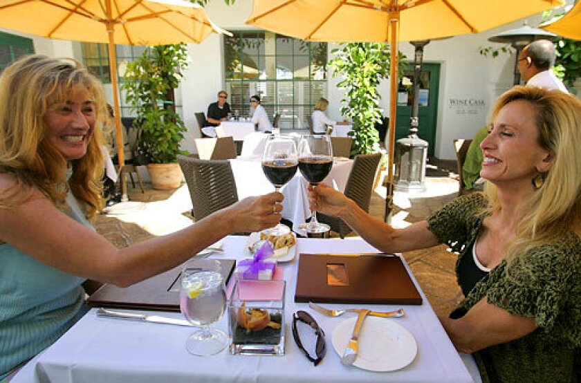 Marla Feierabend and Pat Altavilla share a toast at Santa Barbara's long-running Wine Cask restaurant.