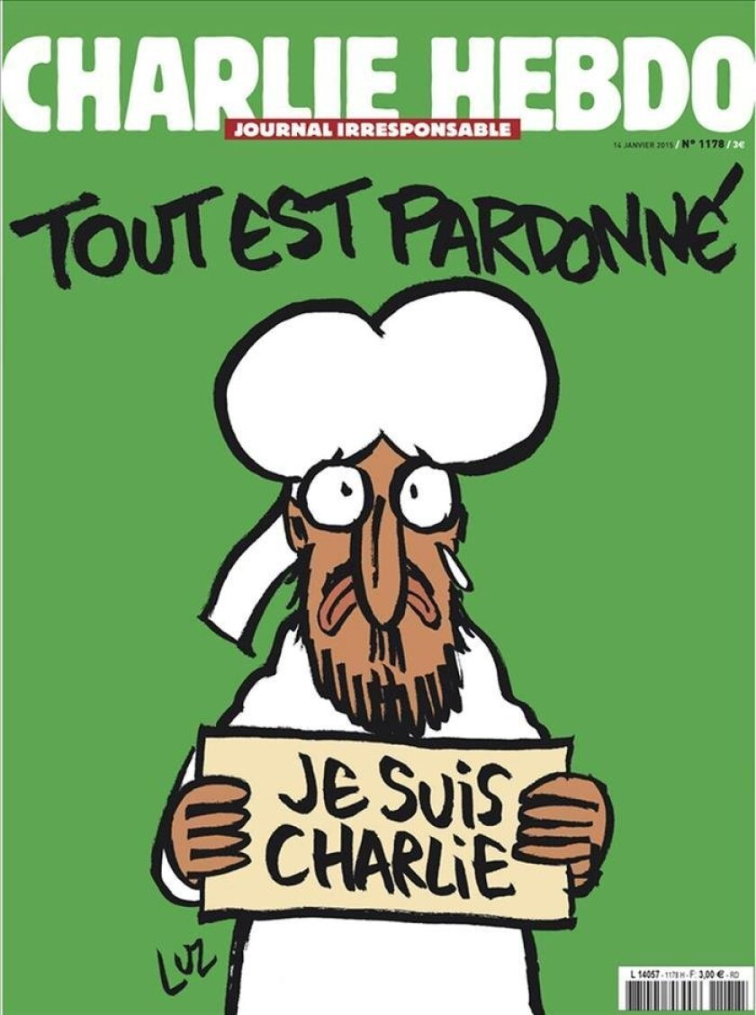 """The satirical magazine 'Charlie Hebdo' has chosen as the cover for this week's edition to be a caricature of Prophet Mohammad holding a sign saying """"Je suis Charlie"""" (I am Charlie), the slogan for solidarity adopted after the deaths of 12 people in the Islamist terror attack on its office last week. EFE/CHARLIE HEBDO"""