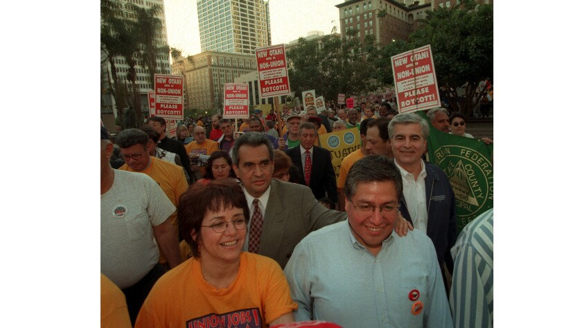 Miguel Contreras and Maria Elena Durazo at a protest in 1997.