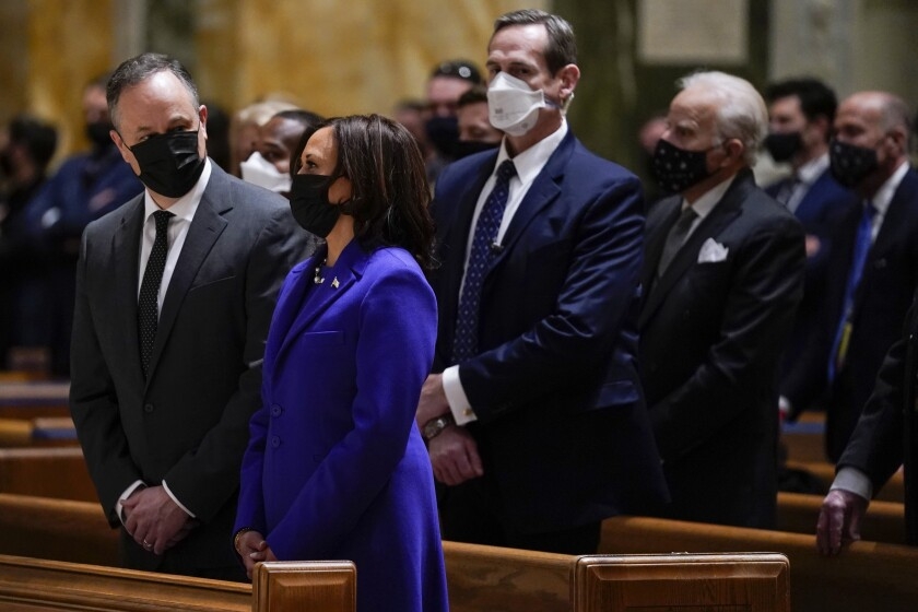 Vice President-elect Kamala Harris and her husband, Doug Emhoff, attend Mass before her inauguration Wednesday.