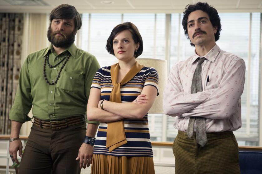 "Jay R. Ferguson as Stan Rizzo, Elisabeth Moss as Peggy Olson and Ben Feldman as Michael Ginsberg in Episode 4 of ""Mad Men,"" Season 7."