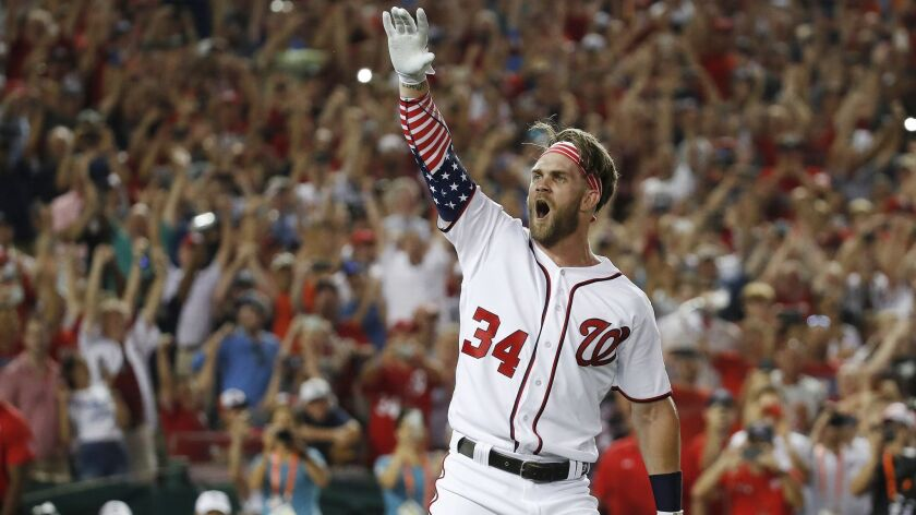 Bryce Harper celebrates winning the 2018 Home Run Derby. A $1-million prize for the winner of the event is one of several MLB changes.