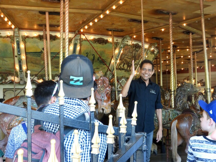 Julio Gosdinski welcomes riders to the Griffith Park carousel, where he worked for three decades.