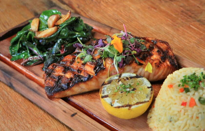 Honey-pepper cedar plank salmon at Intertwined Bistro & Wine Bar in Escondido.