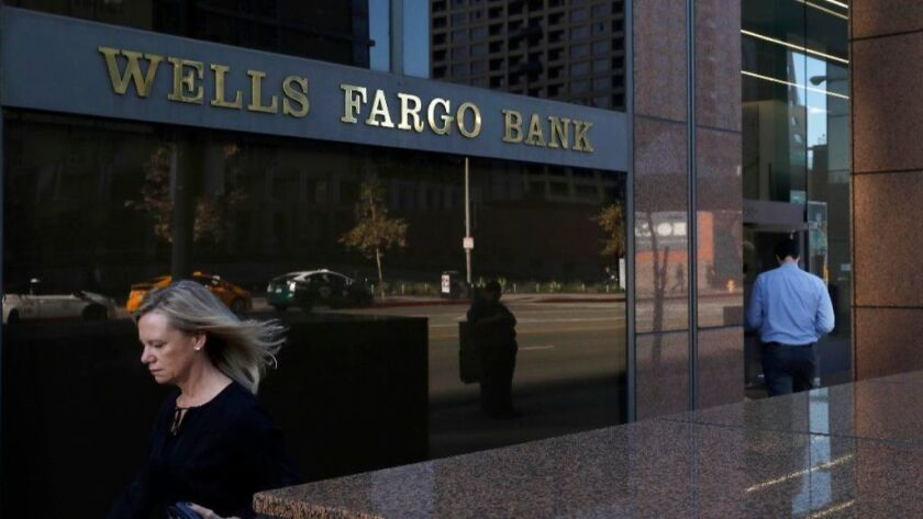A pedestrian walks past Wells Fargo's downtown Los Angeles offices.