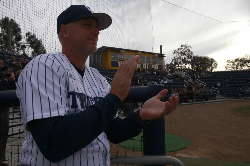 UCSD Tritons head coach Eric Newman applauds during a brief ceremony dedicating the new baseball field and thanking those responsible for getting the project completed.