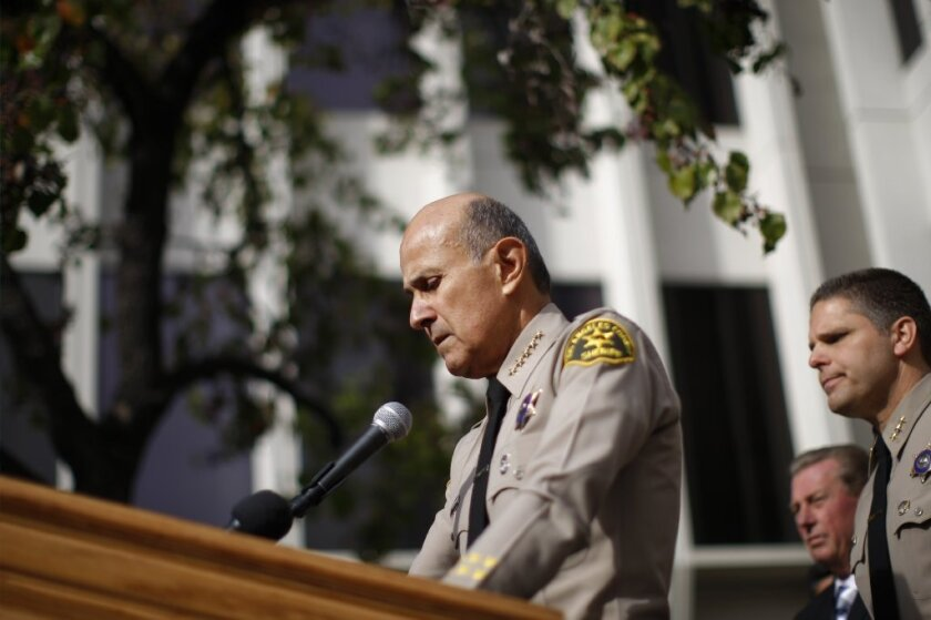 Los Angeles County Sheriff Lee Baca, who had said he would run for a fifth term, is seen on Tuesday announcing his resignation.