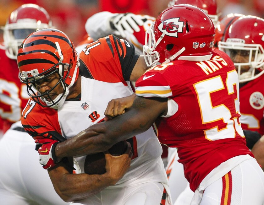 Kansas City Chiefs linebacker Joe Mays, right, sacks Cincinnati Bengals quarterback Jason Campbell (17) in the first half of an NFL preseason football game Thursday, Aug. 7, 2014, in Kansas City, Mo. (AP Photo/Colin E. Braley)
