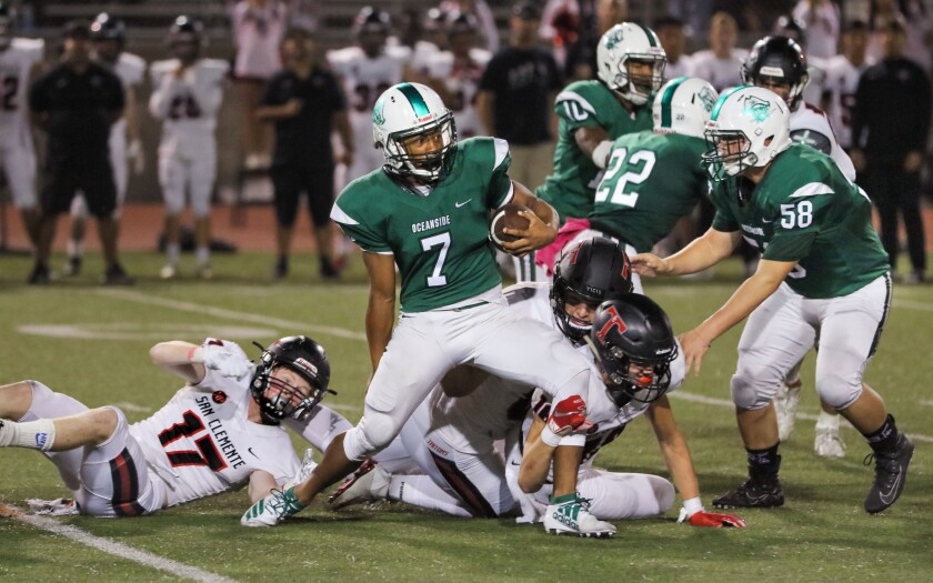 Oceanside running back Kavika Tua (shown in an earlier game) scored the winning points for the Pirates in overtime on Friday night.