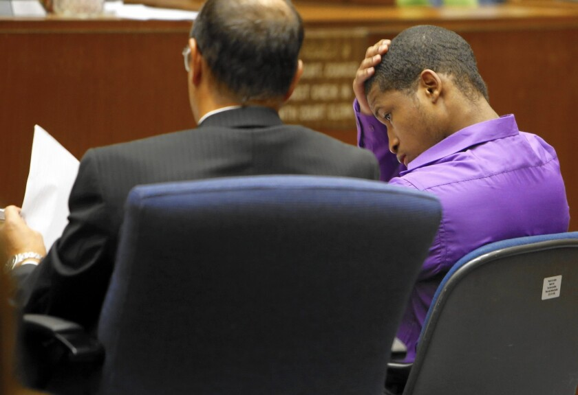 Javier Bolden, right, sits with his defense attorney, Andrew Goldman, during his trial in Los Angeles County Superior Court.