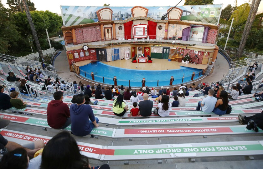 SeaWorld patrons watch a holiday show featuring sea lions Clyde and Seamore.