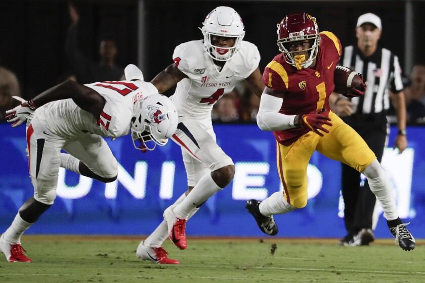Velus Jones returns a kickoff against Fresno State at the Coliseum on Aug. 31, 2019.