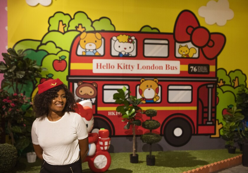 Christina Dahl, dressed up as a flight attendant, inside the London room at the Hello Kitty Friends Around the World Tour pop-up