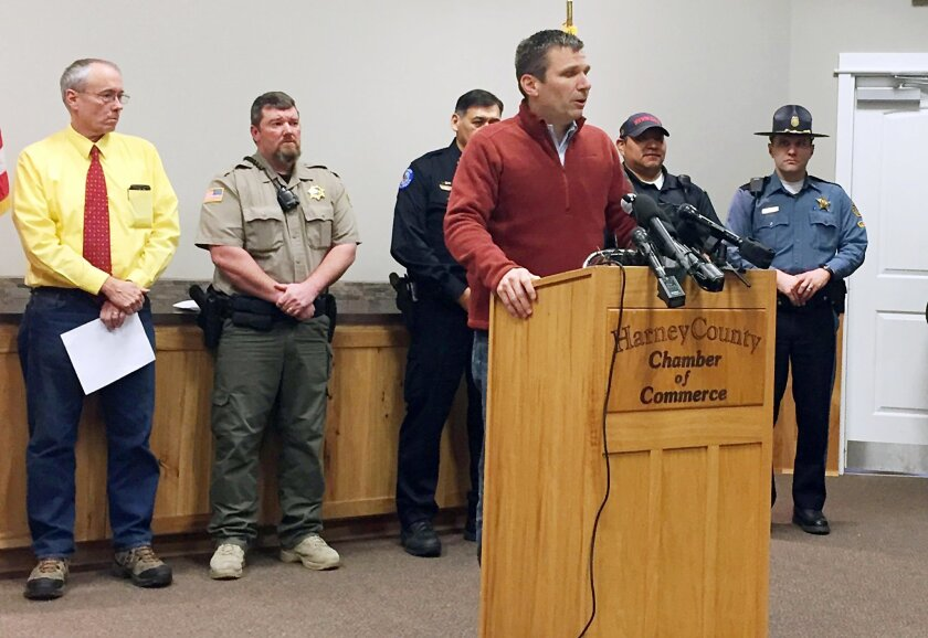 FBI Special Agent in Charge Greg Bretzing, at podium, talks to reporters at the Chamber of Commerce in Burns, Ore., Thursday, Feb. 11, 2016. The end of a nearly six-week-long standoff at an Oregon wildlife refuge played out live on the Internet, with tens of thousands of people listening as support
