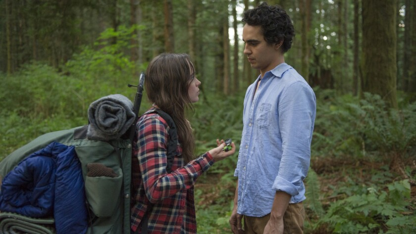 "Ellen Page and Max Minghella in the movie ""Into the Forest."""