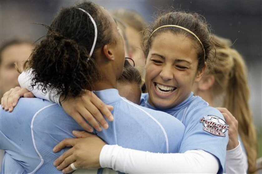 North Carolina's Casey Nogueira hugs Jessica McDonald after she assisted on McDonald's goal in the first half during the NCAA college women's soccer championship final, on Sunday, Dec. 6, 2009, in College Station, Texas. North Carolina won 1-0. (AP Photo/Bob Levey)