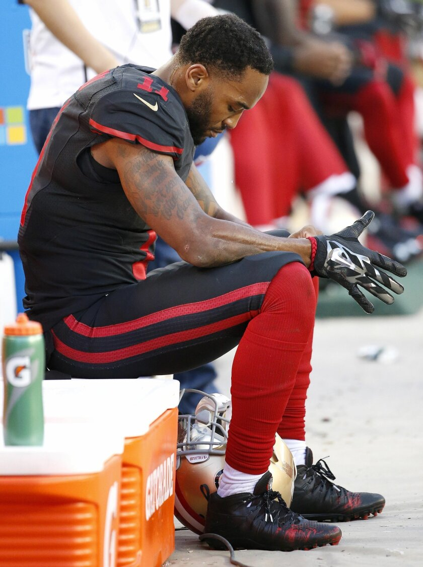 San Francisco 49ers wide receiver Quinton Patton (11) sits on the sideline during the second half of an NFL football game against the Arizona Cardinals in Santa Clara, Calif., Sunday, Nov. 29, 2015. The Cardinals won 19-13. (AP Photo/Tony Avelar)