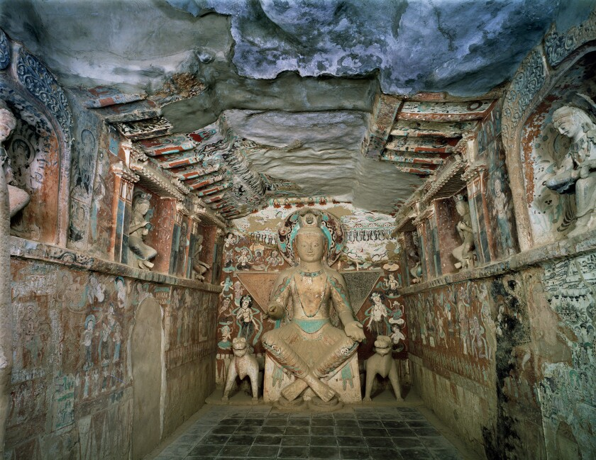 Cave 275 is from the Northern Liang dynasty of the 5th century. The Mogao Grottoes were used as Buddhist temples and were commissioned by wealthy art patrons.