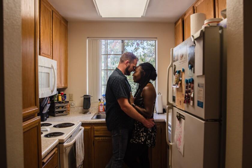 Kashmone Hamilton and Richard Alberts in their apartment in La Mesa
