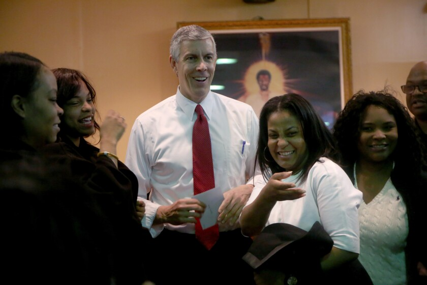 Arne Duncan speaks with people in the crowd on the day of his last speech as U.S. secretary of education during a visit to St. Sabina Catholic Church on Dec. 30, 2015, in Chicago.