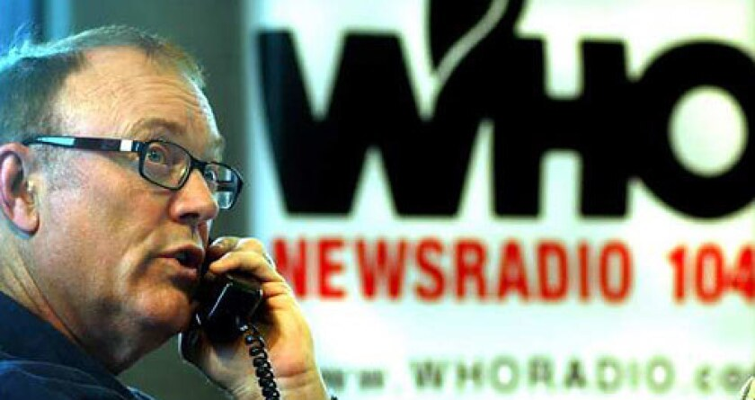 Jan Mickelson, the leading conservative radio personality in Iowa, talks with a caller during his show.