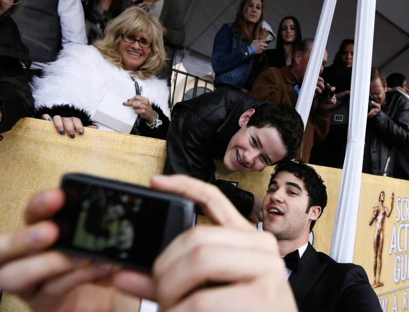 """Actor Darren Criss of """"Glee,"""" bottom right, poses for a photo with fan Coby Hillborne, 16, of Woodland Hills, at the 19th Screen Actors Guild Awards."""