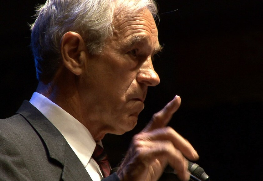 Ron Paul meets with reporters during a 2008 news conference. White separatist William Johnson tried to affiliate himself with Paul that year when running for Los Angeles Superior Court judge. Johnson this year was selected as a delegate for Donald Trump.