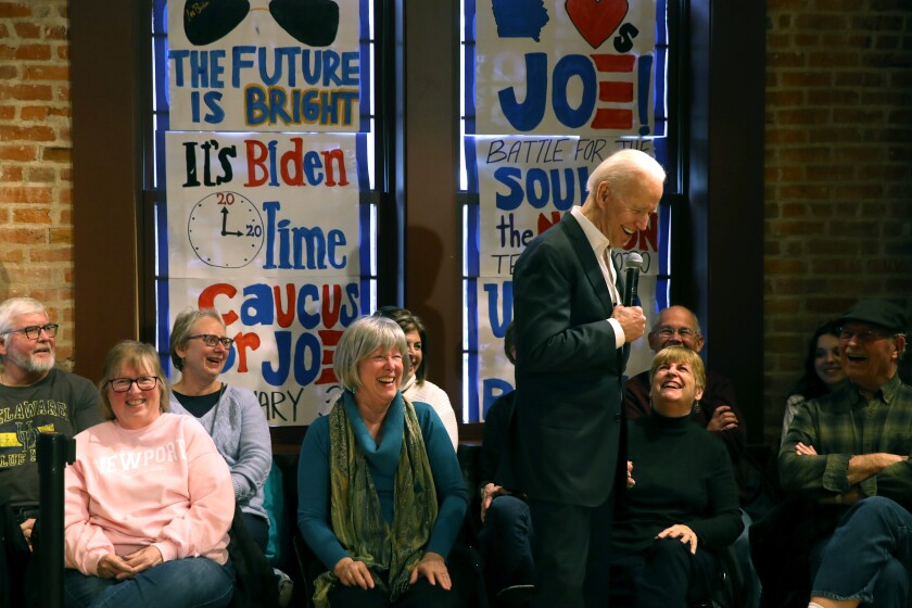 Democratic presidential candidate former Vice President Joe Biden laughs with members of the audience during a campaign event at Vince Meyer Learning Center in Newton, Iowa.