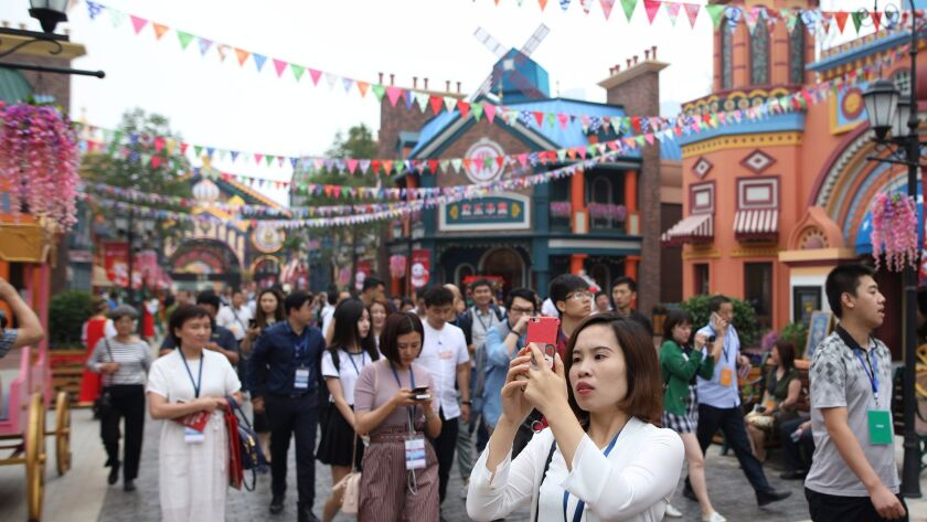 Visitors at Harbin Wanda City's theme park in northeast China during its June 30 opening.