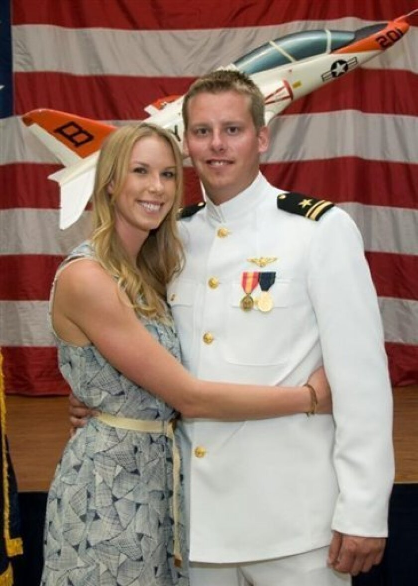 This 2011 photo provided by the Reis family shows Karen Reis, left, and her brother David Reis at his winging ceremony for the Navy. The Reis siblings were among the four people found dead in a New Year's Day shooting at a condominium in a toney neighborhood on San Diego Bay, the victims' father sa