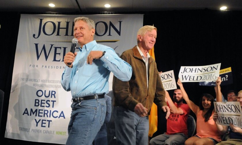 Libertarian presidential candidate Gary Johnson. left, takes the stage after being introduced by his running mate Bill Weld during a campaign rally late last summer in Albuquerque, N.M.
