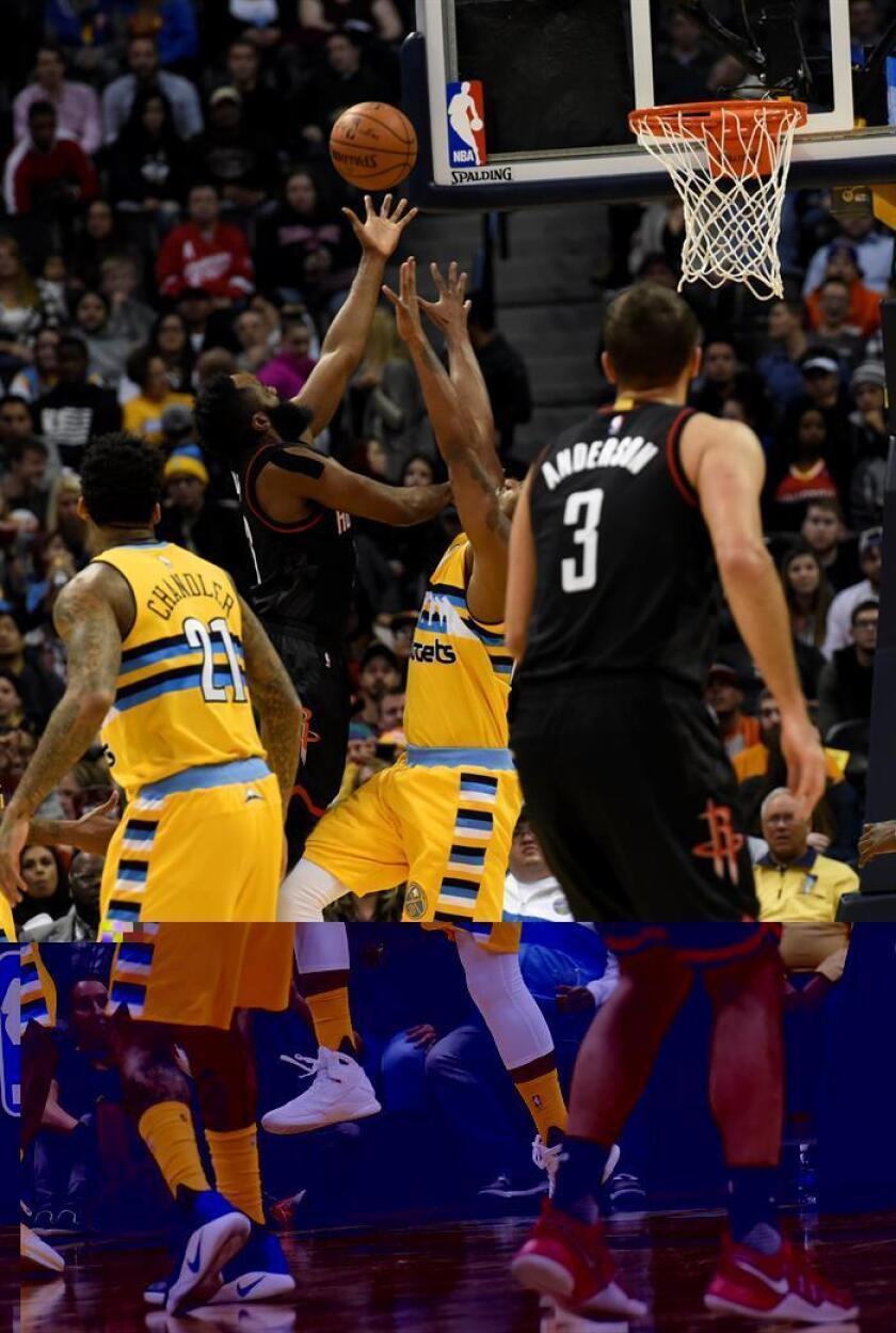 El jugador de los Nuggets Darrell Arthur (c d) disputa el balón con James Harden, de los Rockets, durante el partido de hoy de la NBA. EFE
