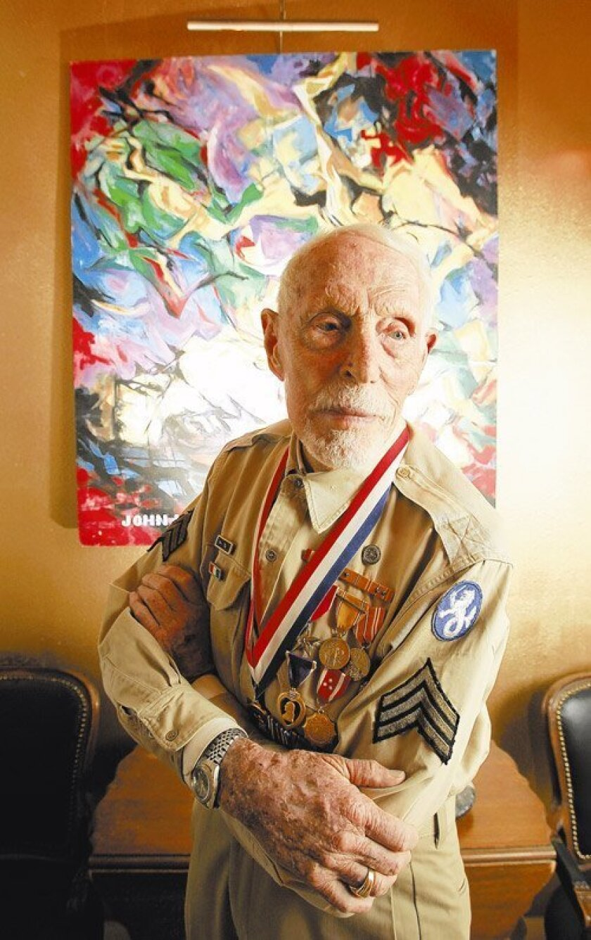Valley Center artist Don Schloat is a World War II veteran who recently dedicated a memorial in the Philippines  to 139 American POWs massacred by their Japanese captors Dec. 14, 1944. Prisoners at the camp, on the island of Palawan, were killed when the Japanese thought the island was being retake