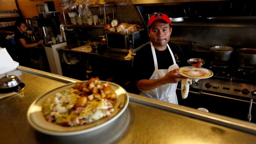 LOS ANGELES, CALIF. -- TUESDAY, JUNE 27, 2017: Jesus Matias, an employee for nine years, prepares di