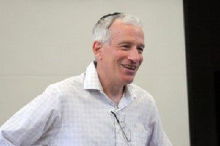 Rabbi Philip Graubart updates the council about Congregation Beth El activities.