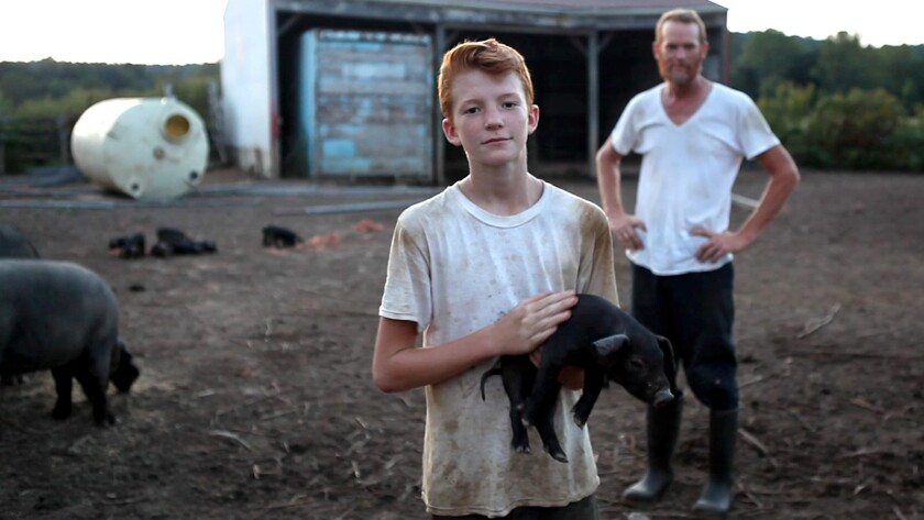 "Hunter Nolan, left and Nick Nolan in ""POV: Farmsteaders"" on PBS."