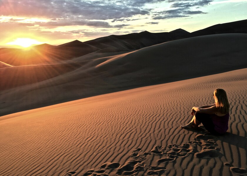 Andrea Kalash at Great Sand Dunes National Park. She made it her mission to visit all 59 full-fledged national parks.