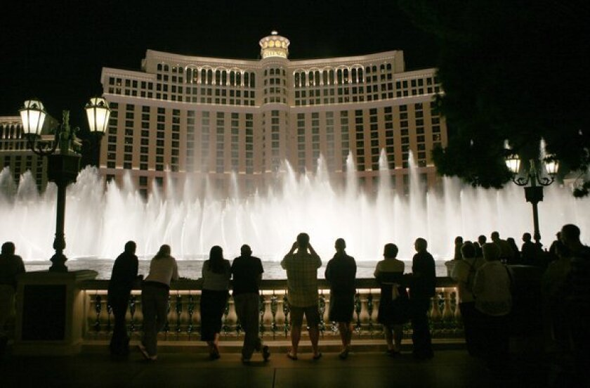 Tourists line up in front of the Bellagio in Las Vegas to watch the water show. An FBI affidavit says an undercover agent paid for Sen. Ronald Calderon (D-Montebello) to attend a Halloween party at the casino last year.