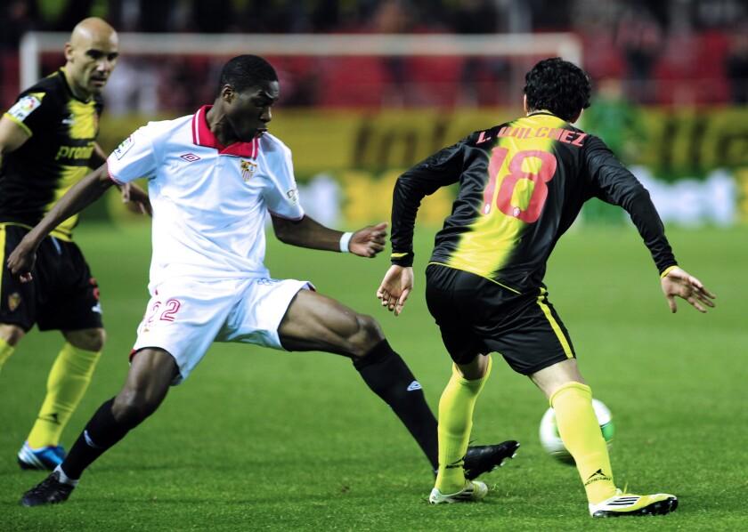 Sevilla defender Geoffrey Kondogbia clears the ball against Zaragoza's Lucas Wilchez during the Copa del Rey quarterfinals on Jan. 23, 2013.